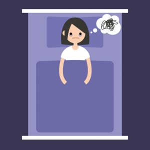 Woman lying in bed worrying